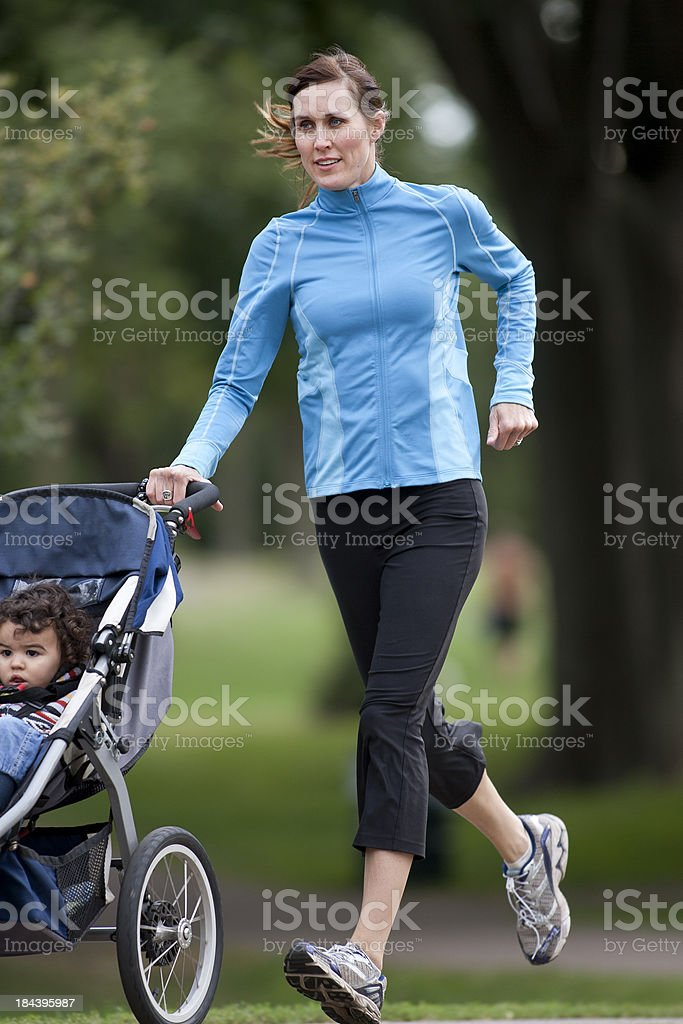 Jogger and Baby stock photo