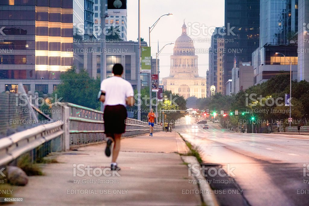 Jogger at dawn running in Austin Texas stock photo