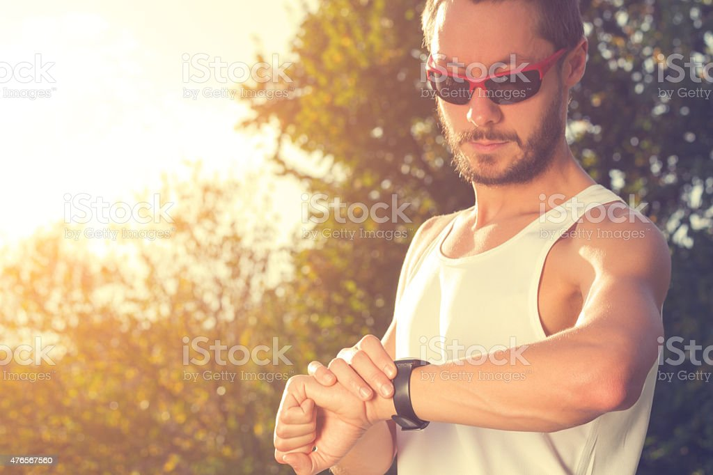 Jogger Checking Running Time stock photo