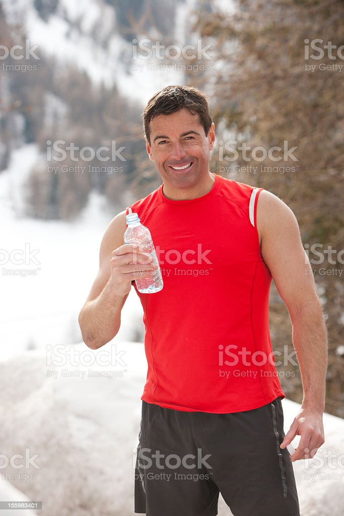 Jogger enjoys his water royalty-free stock photo