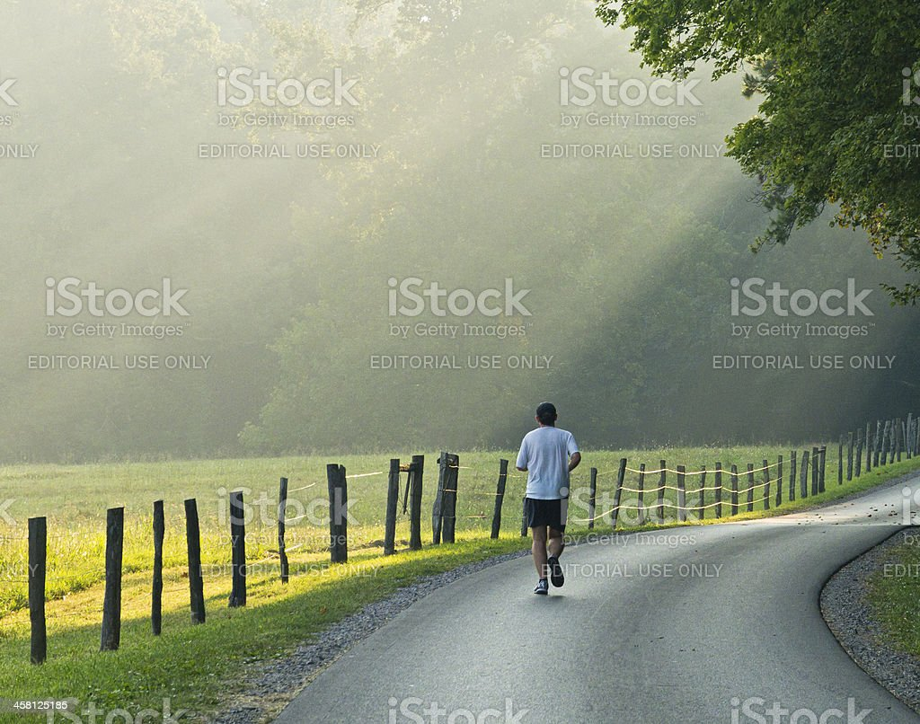 Jogger on a country road in the Smoky  Mountains stock photo