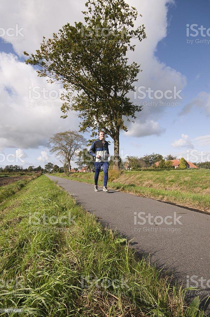 jogger on the way royalty-free stock photo