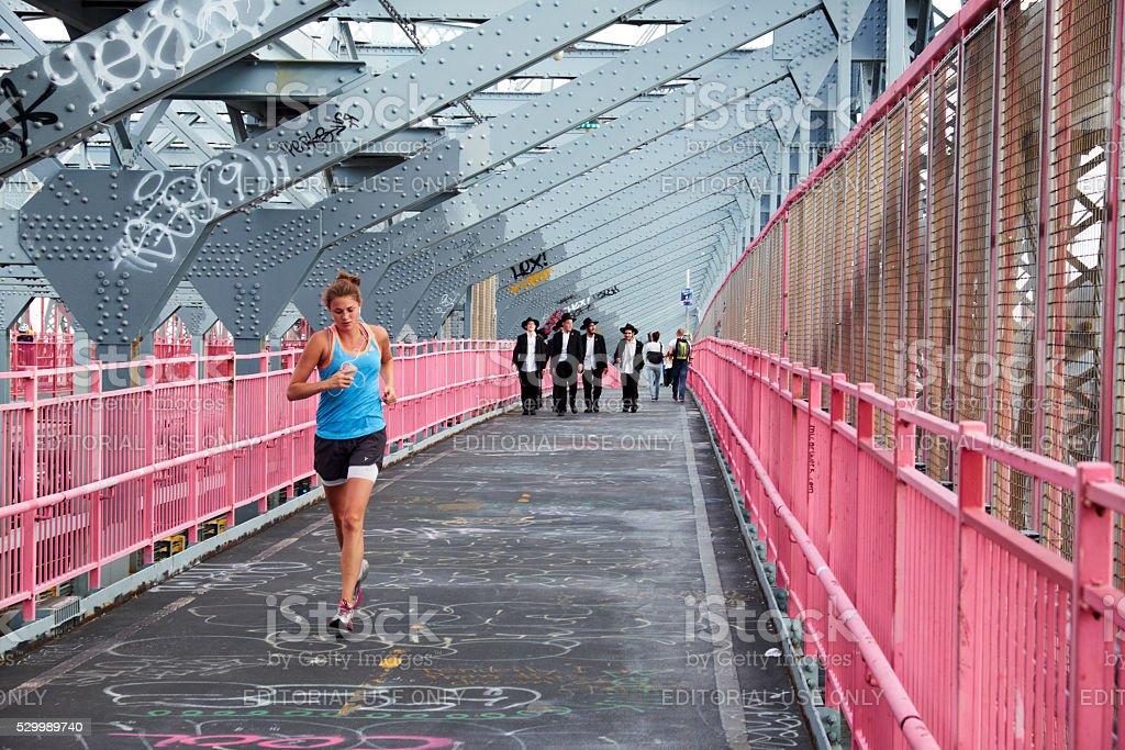 jogger on williamsburg bridge stock photo