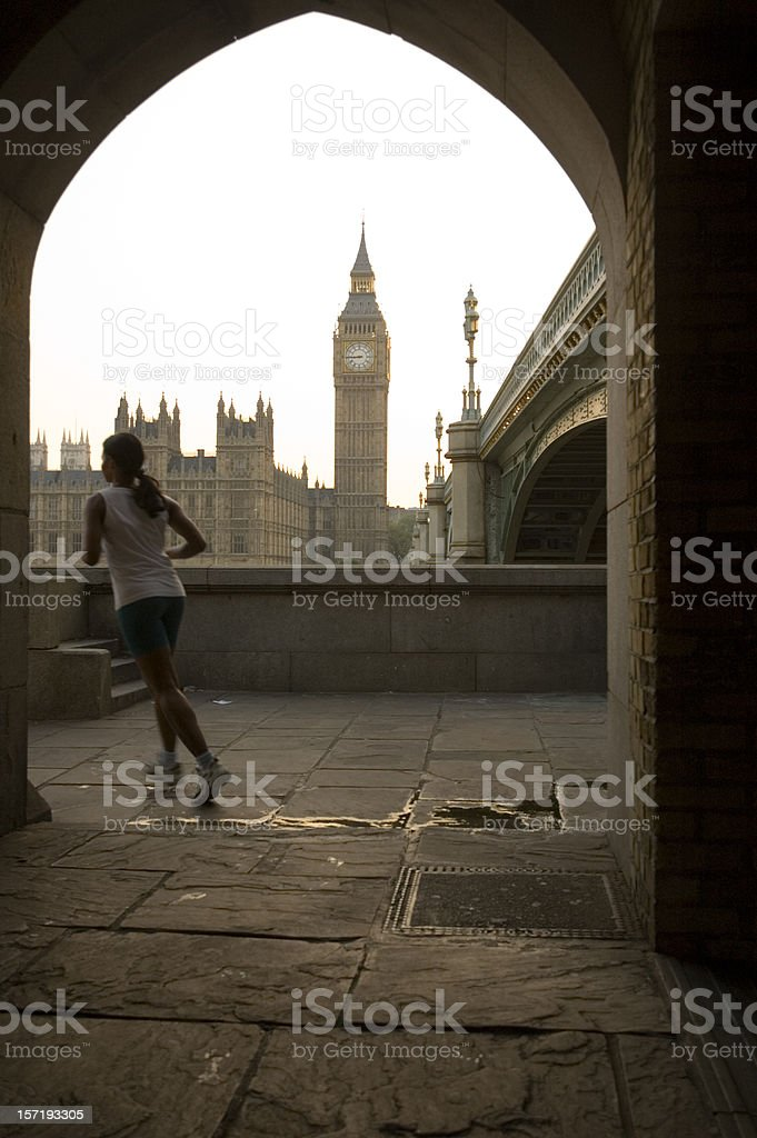 Jogger passing by Big Ben. royalty-free stock photo