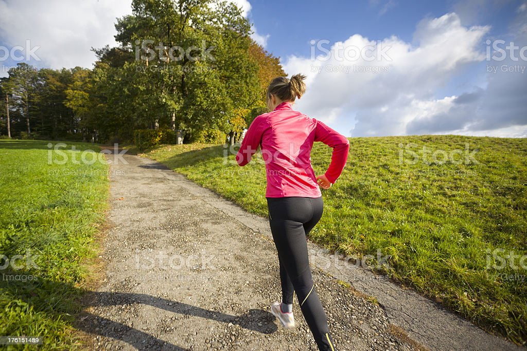 Jogger Running Uphill in Beautiful Green Landscape royalty-free stock photo