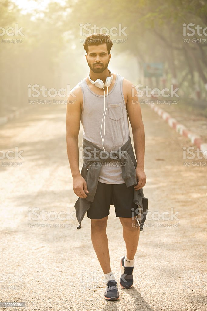 Jogger with headphones at park stock photo