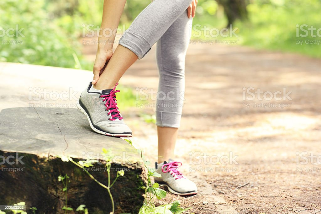 Jogger with hurt ankle stock photo