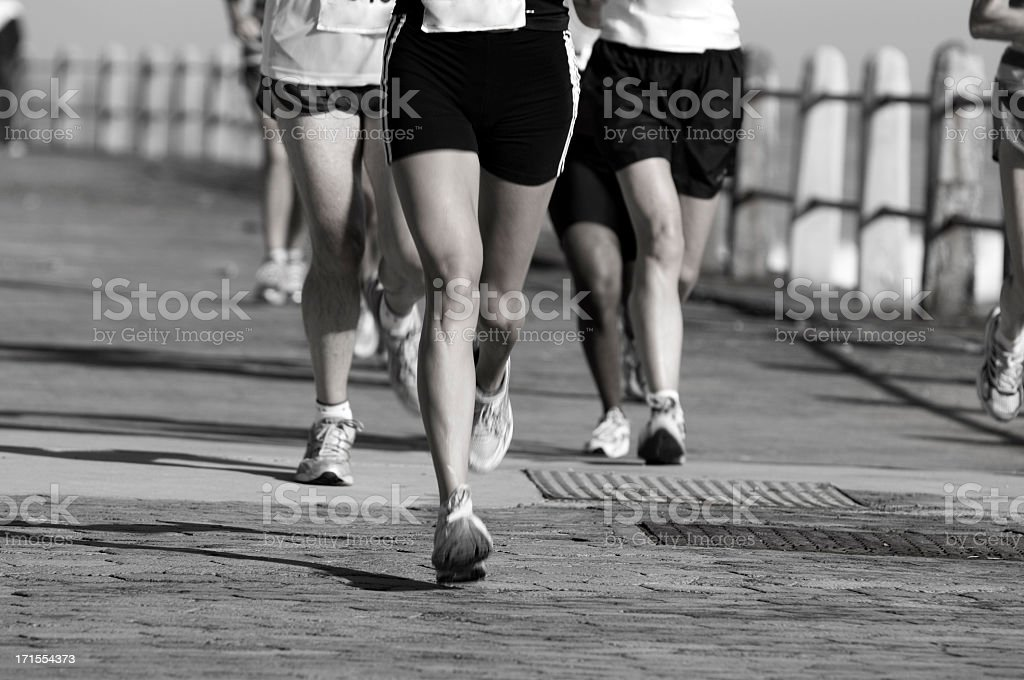 Joggers on the road royalty-free stock photo