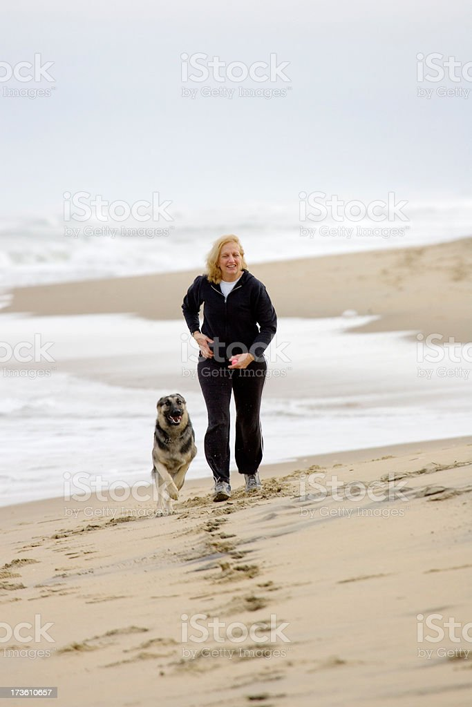 Jogging along the Beach royalty-free stock photo