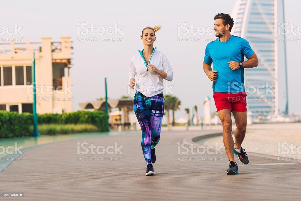 Jogging during sunset in Dubai stock photo