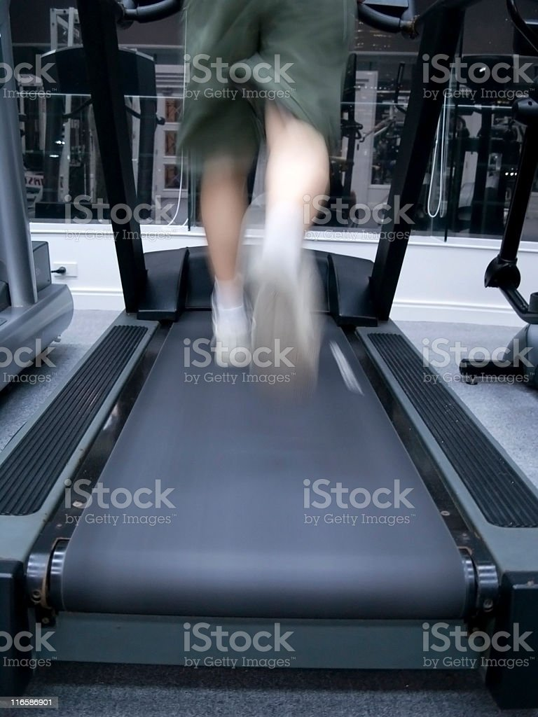 Jogging in a gym royalty-free stock photo