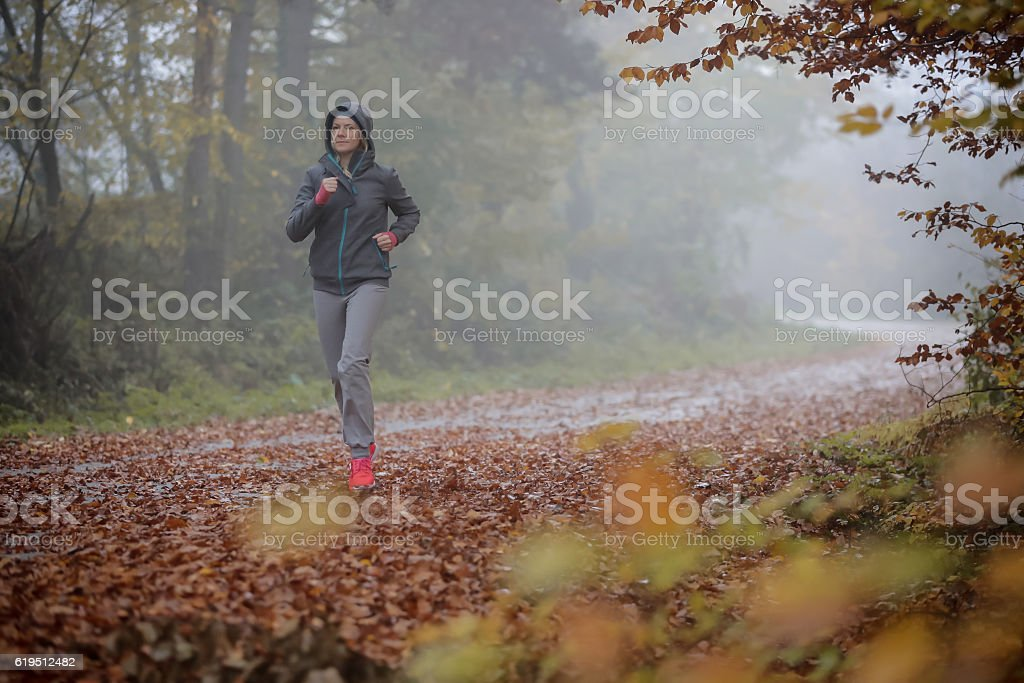 Jogging in any weather stock photo
