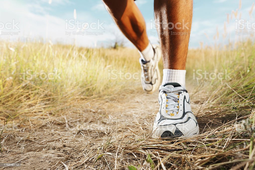 Jogging in nature, close-up shot of foot stock photo
