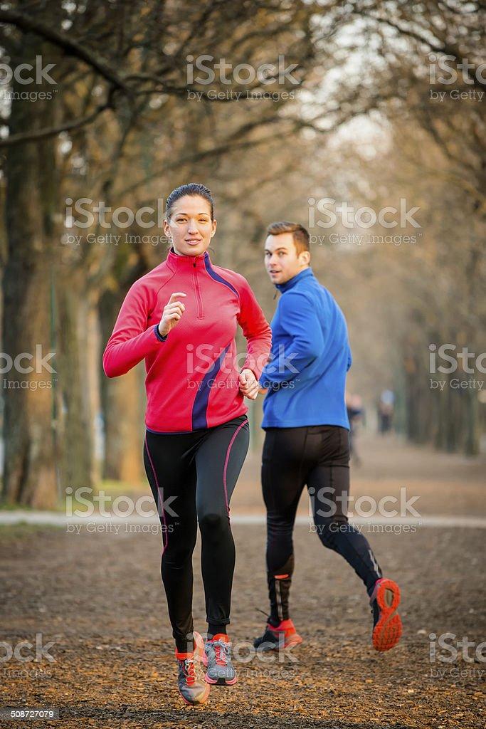 Jogging in park stock photo