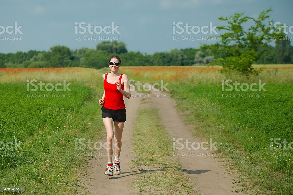 Jogging in the countyside stock photo