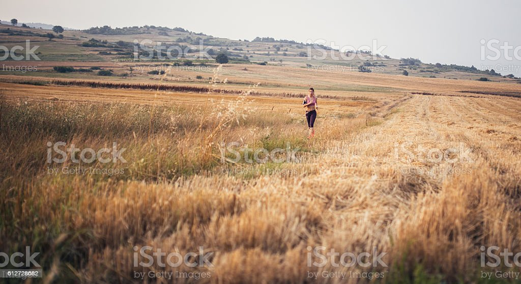 Jogging in the field stock photo