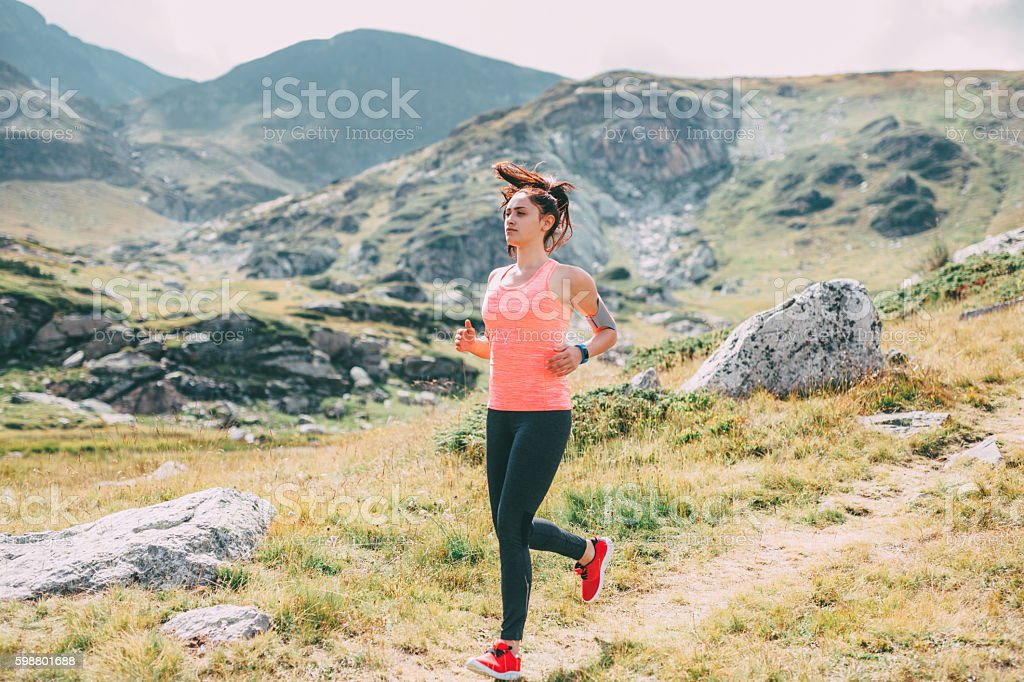 Jogging in the mountain stock photo