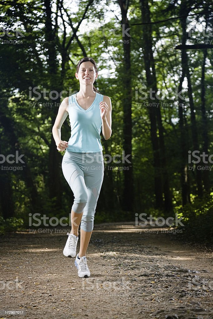 Jogging in the woods stock photo