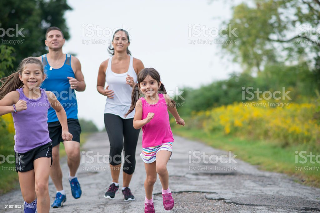 Jogging on a Road Together stock photo