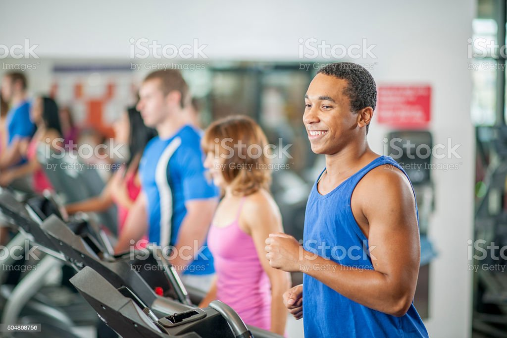 Jogging on a Treadmill at the Gym stock photo