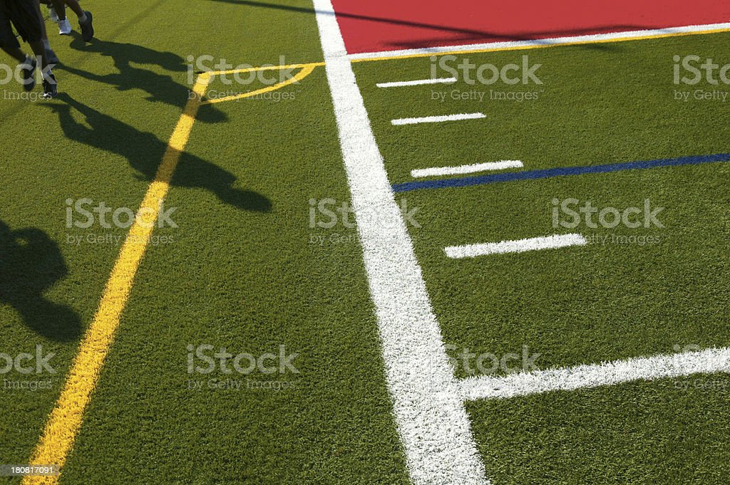 jogging on soccer field stock photo