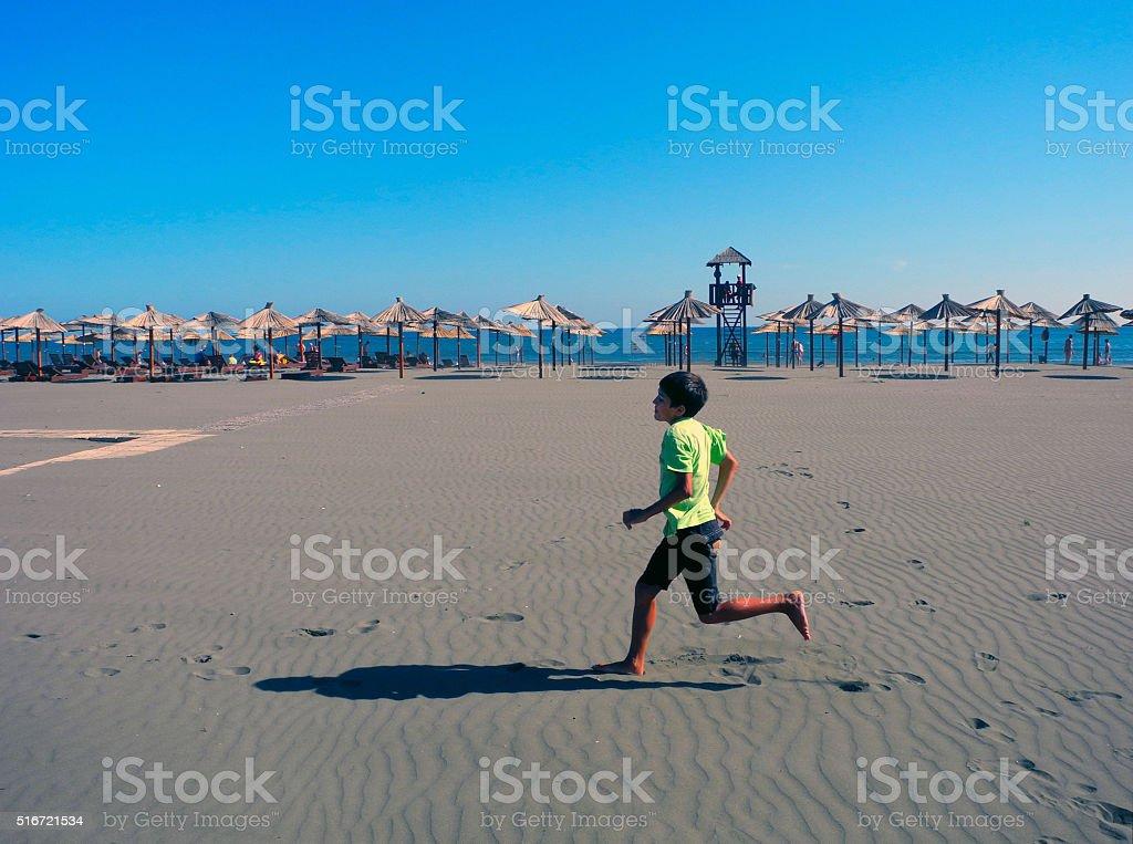 Jogging on the long beach of Ulcinj, Montenegro. stock photo