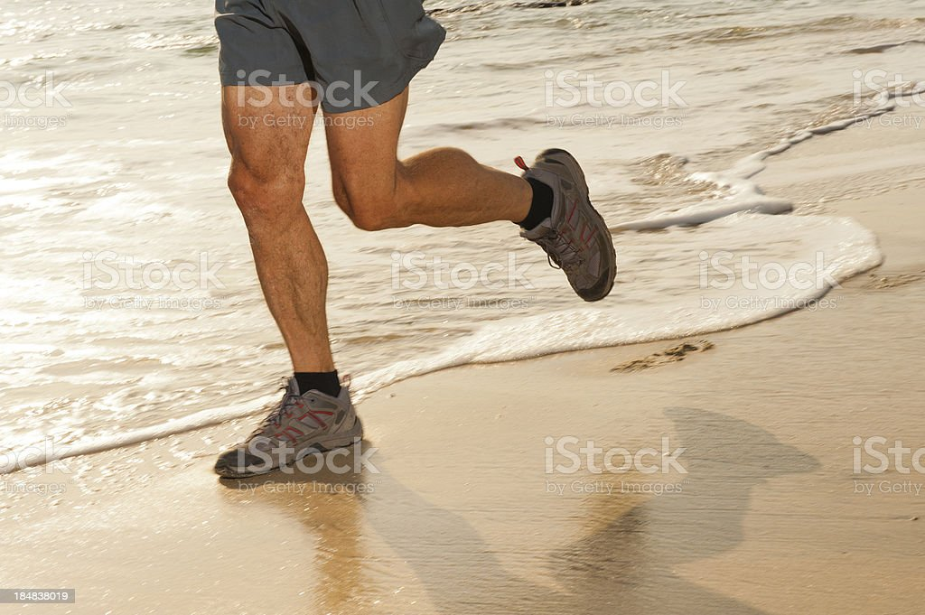 Jogging on the sandy beach royalty-free stock photo