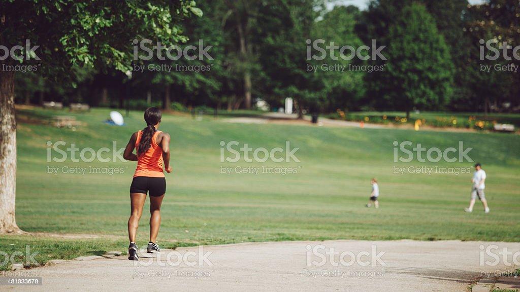 jogging through the city park stock photo