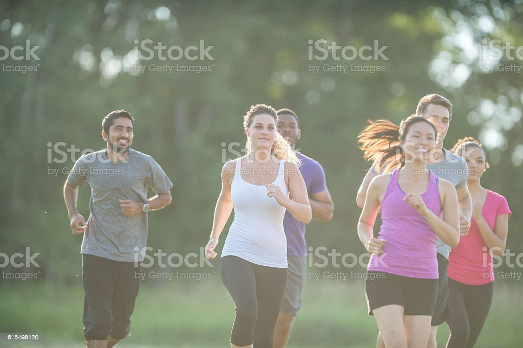 Jogging Together Through the Park stock photo