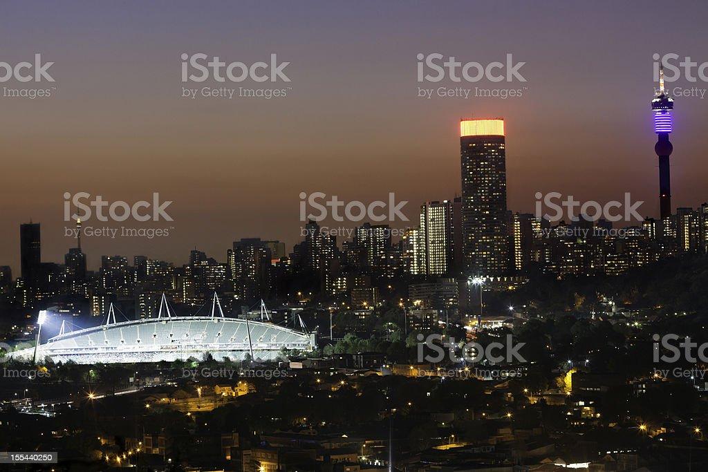 Johannesburg City and Stadium in the evening stock photo