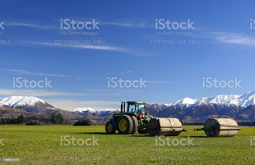 John Deer Tractor And The Southern Alps stock photo