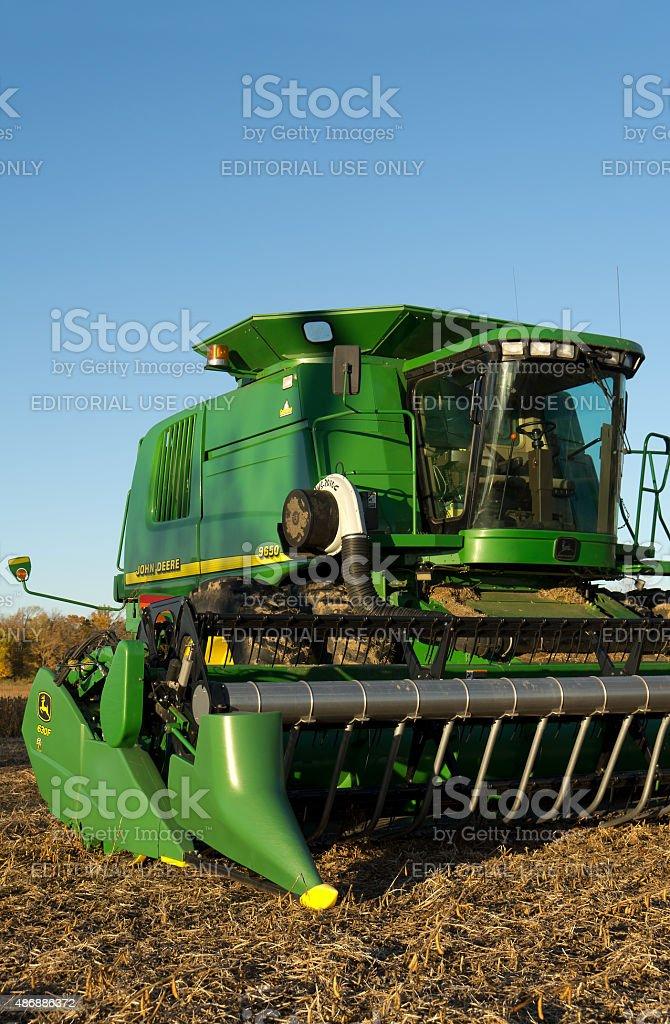 John Deere Combine in Soybean Field stock photo