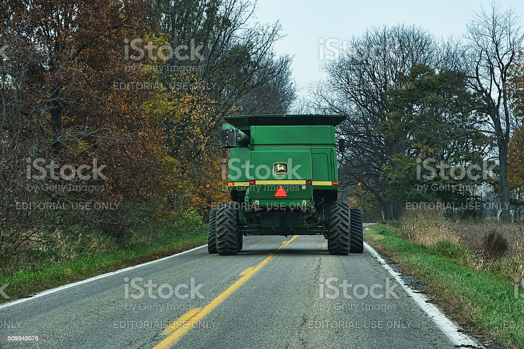 John Deere Combine Roadway View stock photo