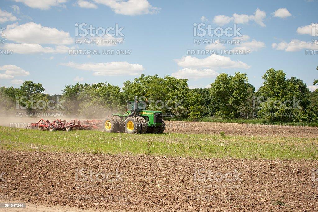 John Deere Tilling Field stock photo