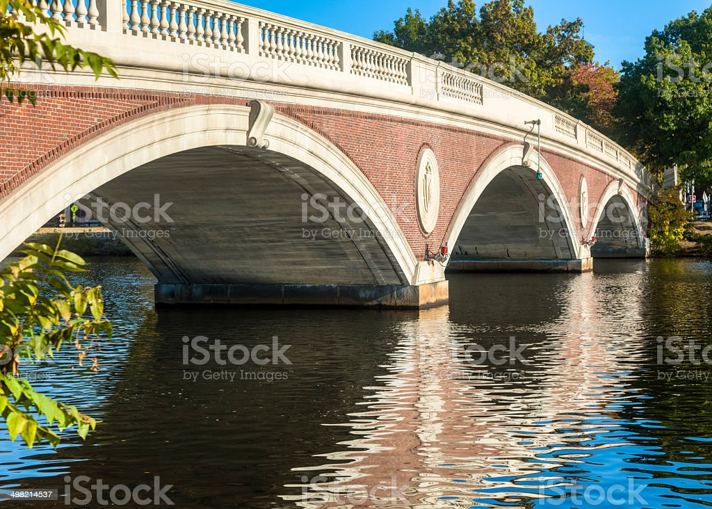 John W. Weeks Bridge Shimmers in Water of Charles River stock photo