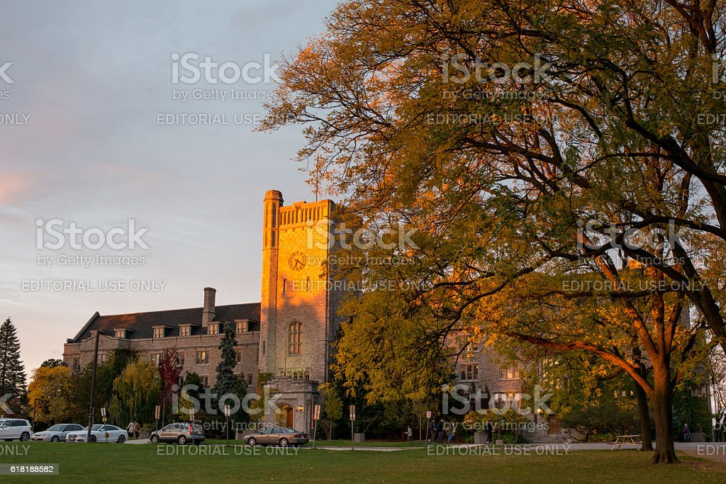 Johnston Hall Clock Tower of Guelph University in sunset stock photo