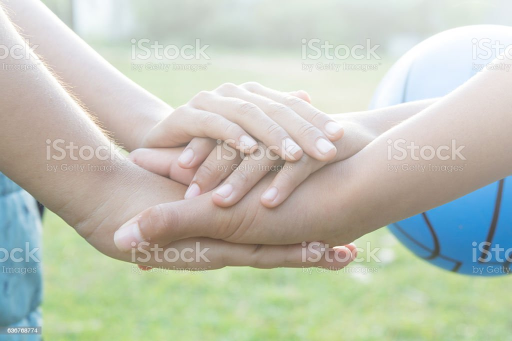 Join   hands Sporting local children on playground stock photo