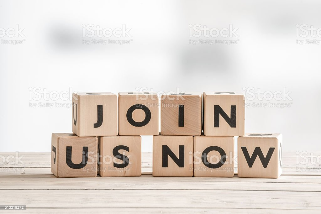 Join us now sign with wooden blocks stock photo