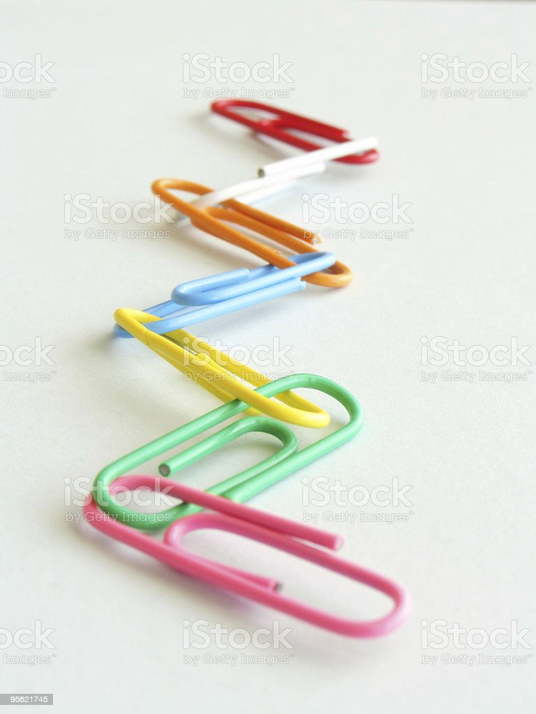 joined coloured paperclips stock photo