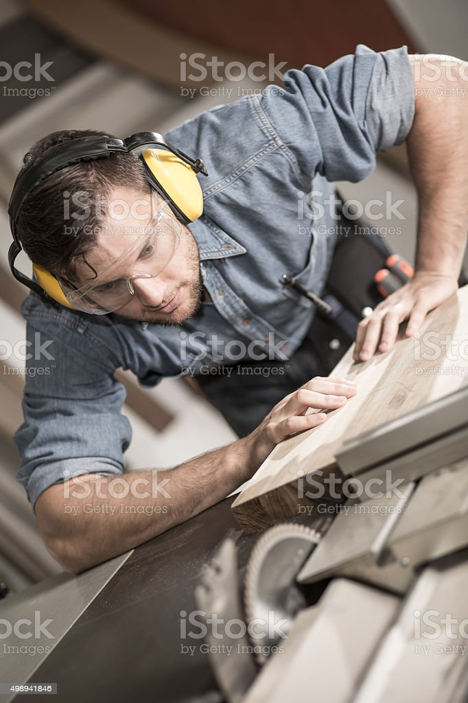 Joiner cutting wood stock photo
