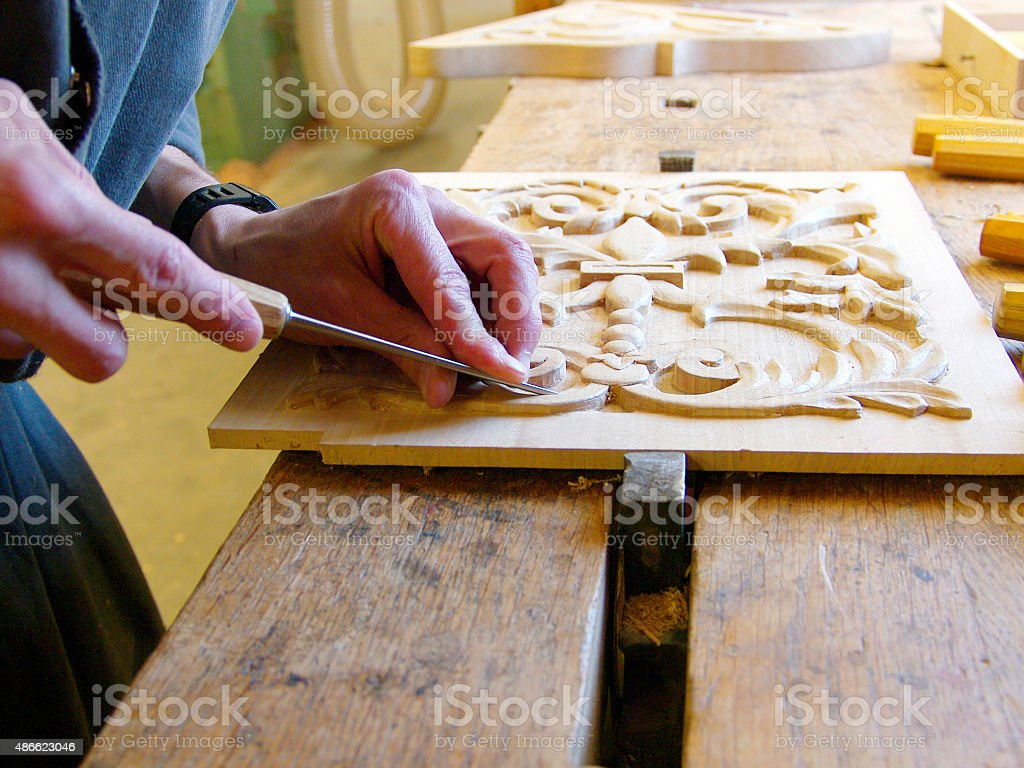 Joiner working on a piece of wood stock photo