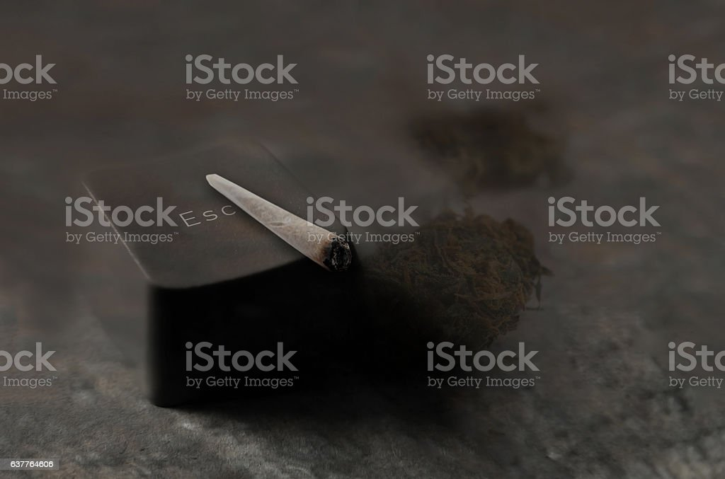 Joint (cannabis) cigarette and hemp leaves. stock photo