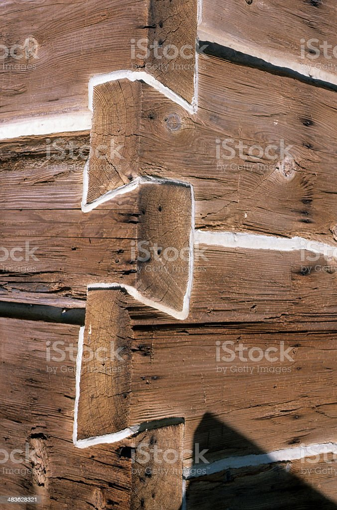 Joints in log cabin wall stock photo