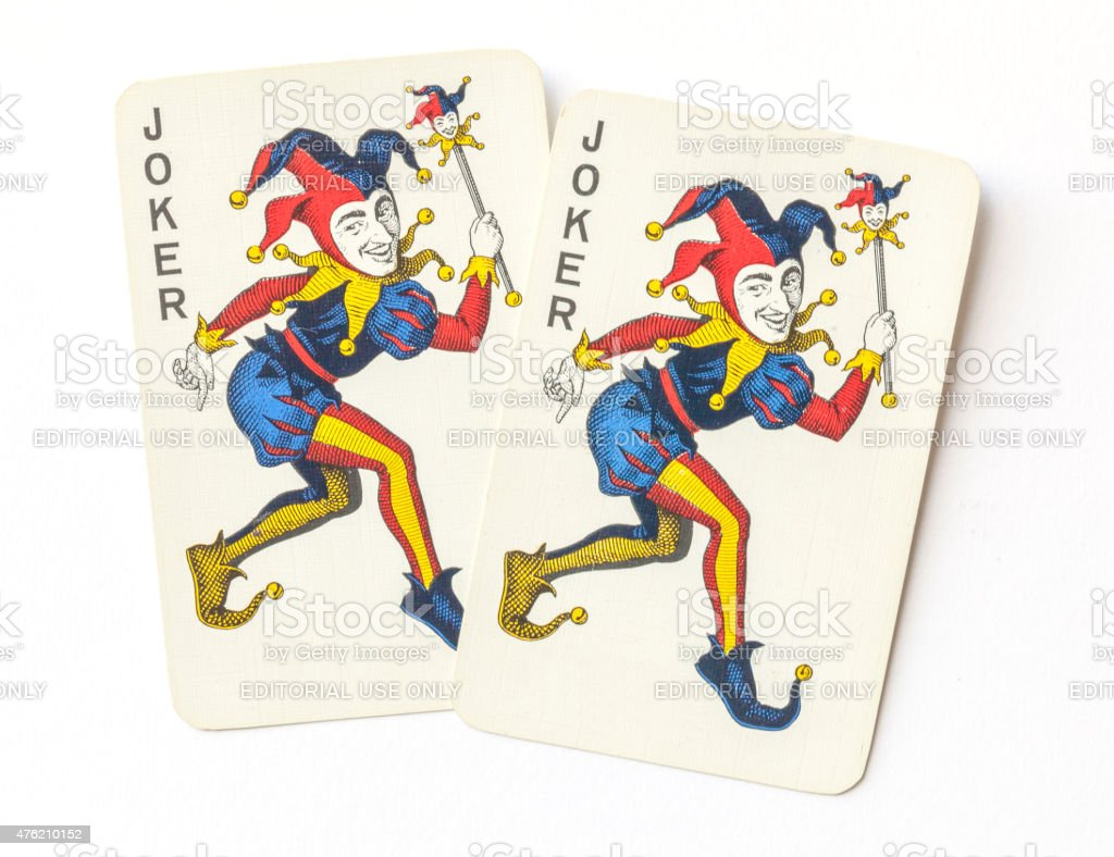 Joker on vintage playing cards. stock photo
