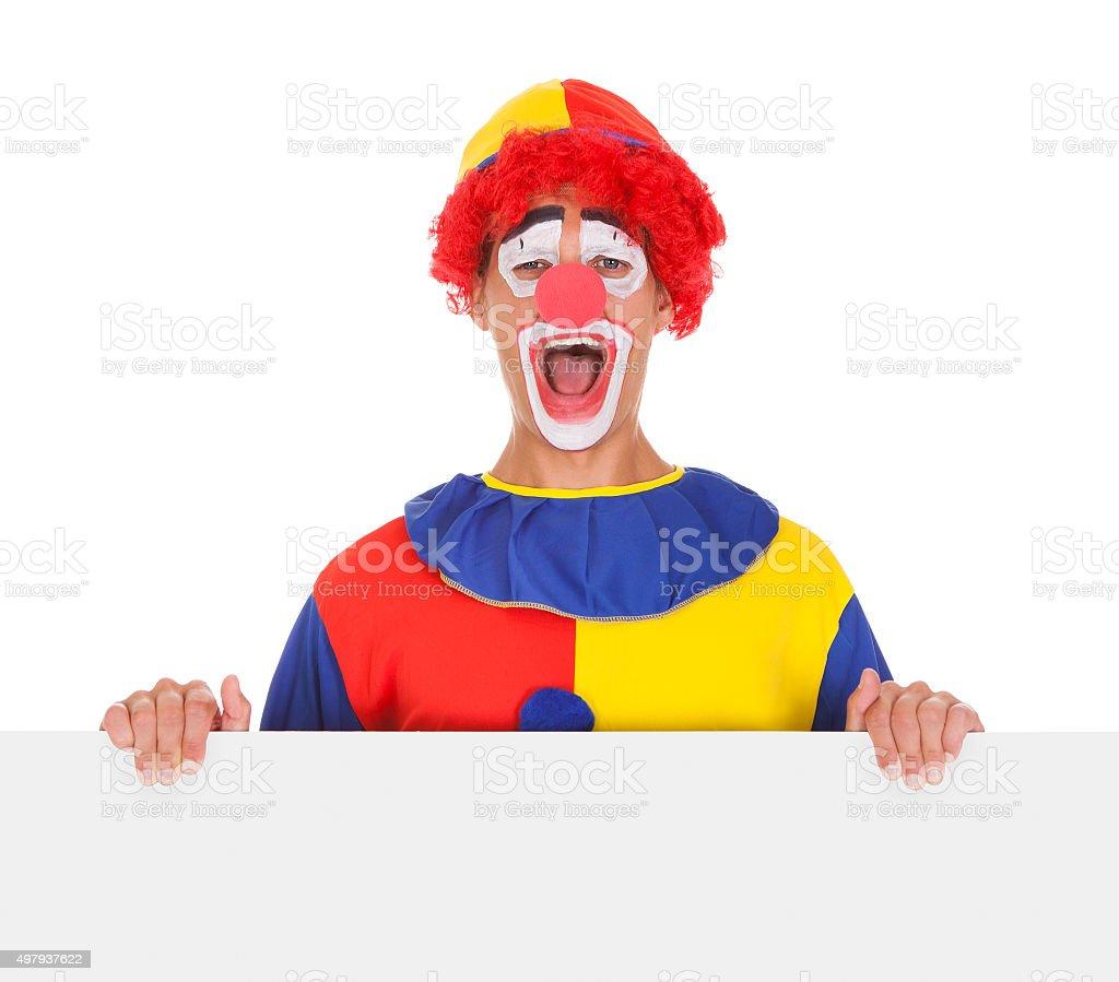 Joker Presenting Blank Placard stock photo