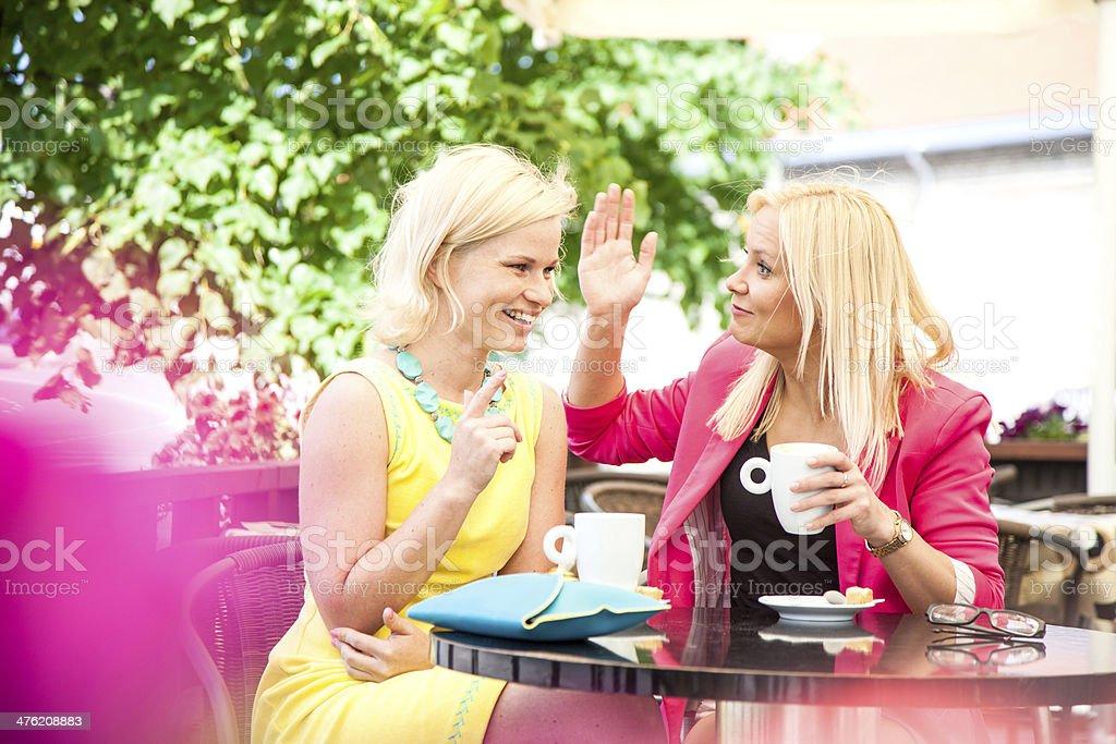 Joking and talking during breakfast royalty-free stock photo