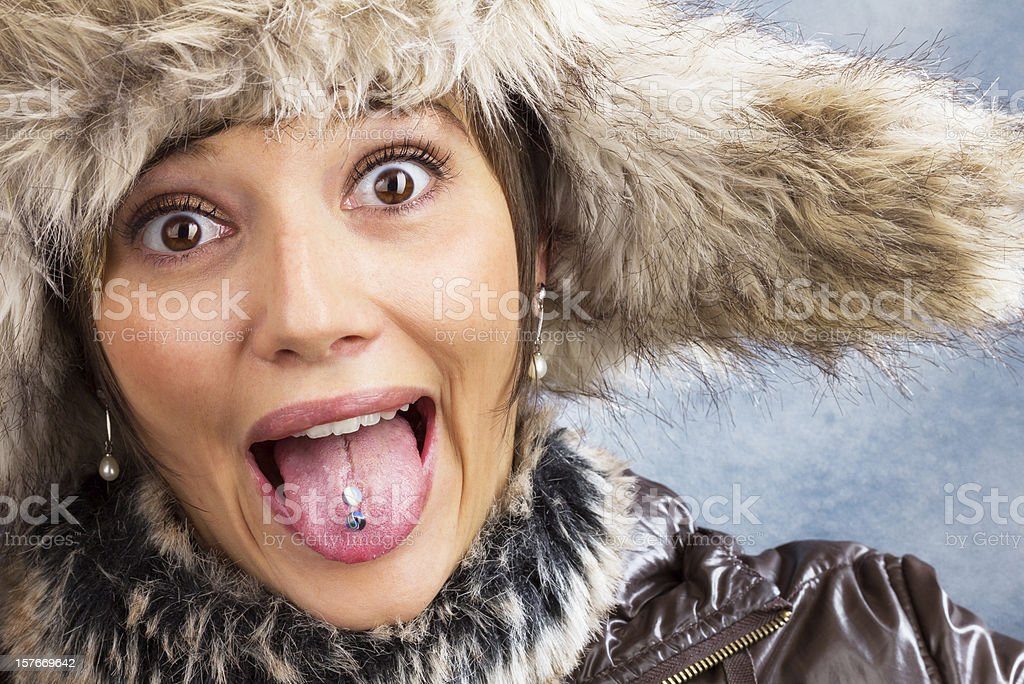 Joking woman with fur hat, close up portrait stock photo