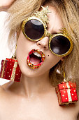 Jolly cheerful beautiful girl in New Year's image with