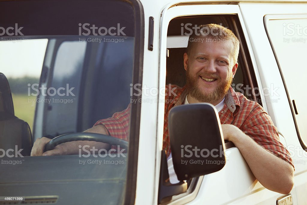 Jolly driver at the wheel of his car stock photo