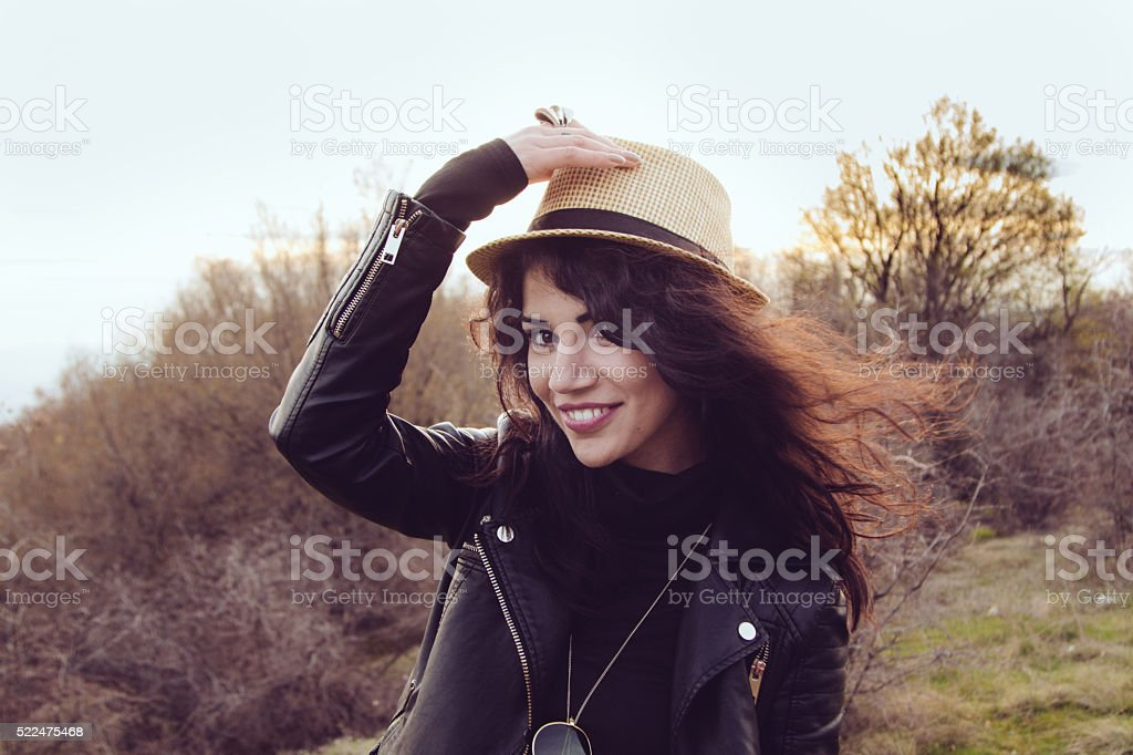 Jolly girl with a cute hat smiling at the camera stock photo